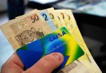 cartão cidadão e dinheiro representando o saque FGTS inativo 2019