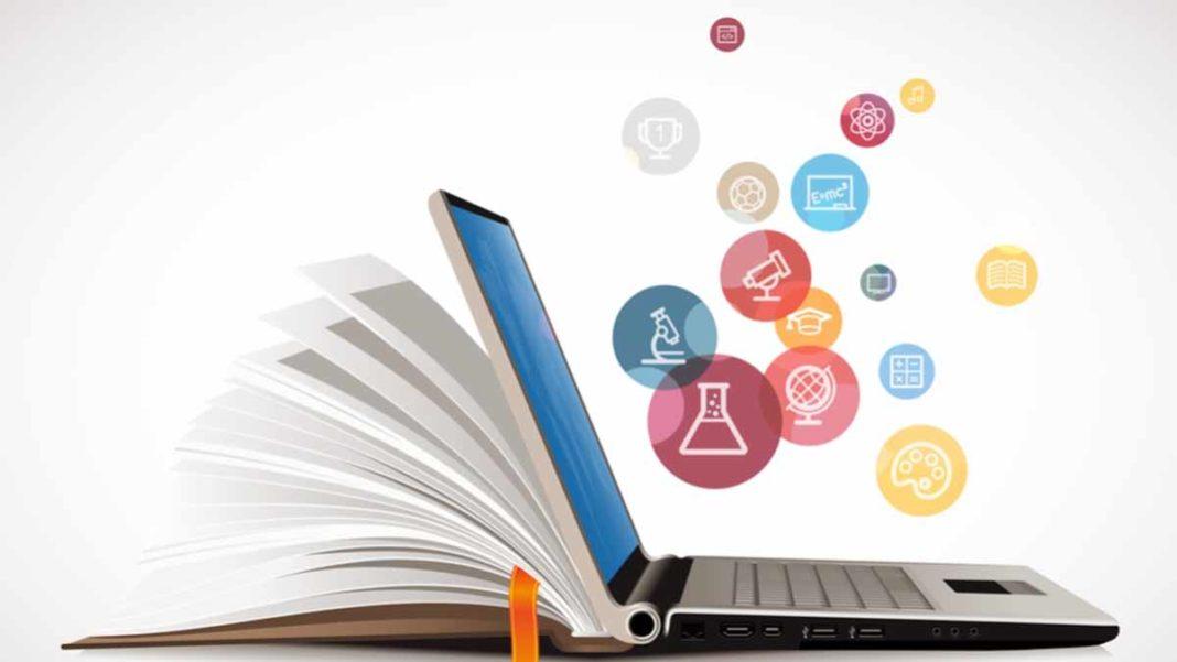 computador como se fosse um livro e saindo muitos icones de venda de dentro dele ensinando como ganhar dinheiro com infoproduto